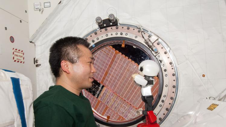 Humanoid communication robot Kirobo and Japanese astronaut Koichi Wakata exchange messages in their first communication session between a robot and a human being in space, at the International Space Station