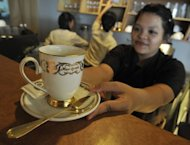 A waitress serves up an expensive cup of Kopi Luwak at a local coffee shop in Jakarta. Single cups of the world's most expensive coffee have been known to sell for almost $100 in specialty outlets in London