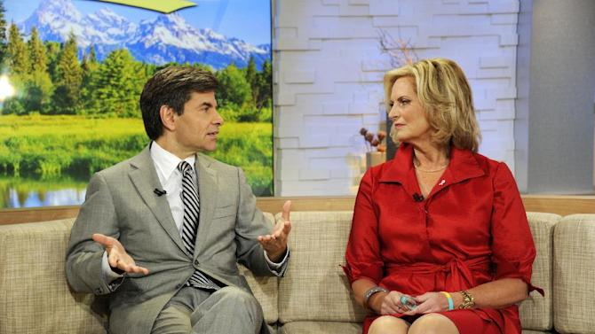 """This image released by ABC shows host George Stephanopoulos, left, speaking with Ann Romney, wife of Republican presidential hopeful Mitt Romney on """"Good Morning America,"""" Wednesday, Oct. 10, 2012 in New York. Romney served as a guest co-host on the popular morning show. (AP Photo/ABC, Ida Mae Astute)"""