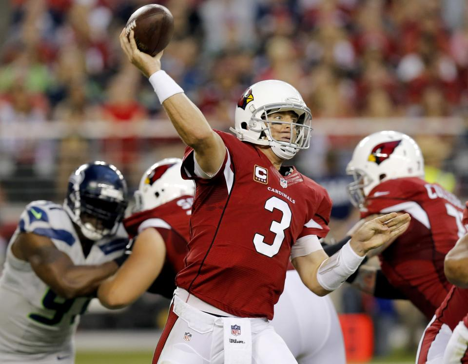 Arizona Cardinals quarterback Carson Palmer (3) throws against the Seattle Seahawks during the first half of an NFL football game, Thursday, Oct. 17, 2013, in Glendale, Ariz. (AP Photo/Ross D. Franklin)