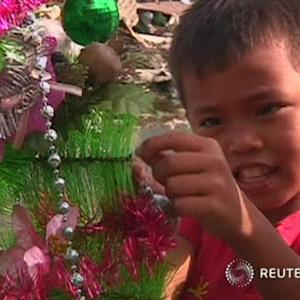 Typhoon victims help clear debris for food and cash