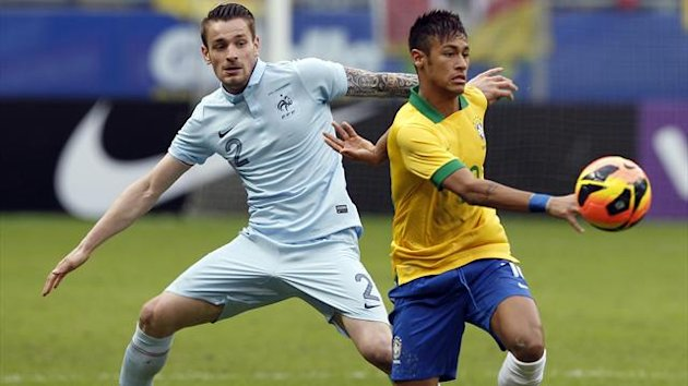 France's Mathieu Debuchy (L) challenges Brazil's Neymar during their international friendly soccer match in Porto Alegre, June 9, 2013. (Reuters)