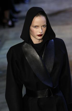 A model wears a creation by Italian designer Stefano Pilati for Yves Saint Laurent as part of the Fall-Winter ready-to-wear 2013 fashion collection, during Paris Fashion week, Monday, March 5, 2012. (AP Photo/Christophe Ena)