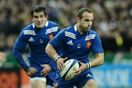 France's fly half Frederic Michalak runs with the ball during their rugby union test match against Australia at the Stade de France in Saint-Denis, north of Paris. Michalak scored 15 points as he steered France to a convincing 33-6 victory over Australia to move the home side into fourth place in the IRB rankings ahead of next month's World Cup draw