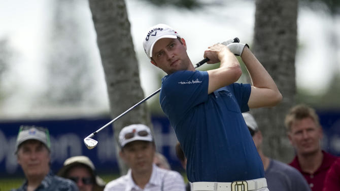 Chris Kirk drives off the fourth tee during the third round of the Sony Open golf tournament on Saturday Jan. 12, 2013, in Honolulu.  (AP Photo/Marco Garcia)