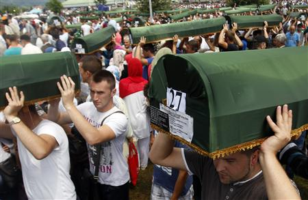 Bosnians carry coffins of 409 newly identified victims of the 1995 Srebrenica massacre in the Potocari Memorial Center, near Srebrenica July 11, 2013. REUTERS/Dado Ruvic