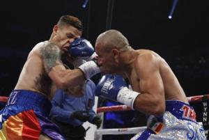 Featherweight boxer Orlando Cruz (L) of Puerto Rico takes a punch from Orlando Salido of Mexico during their title fight at the Thomas & Mack Center in Las Vegas