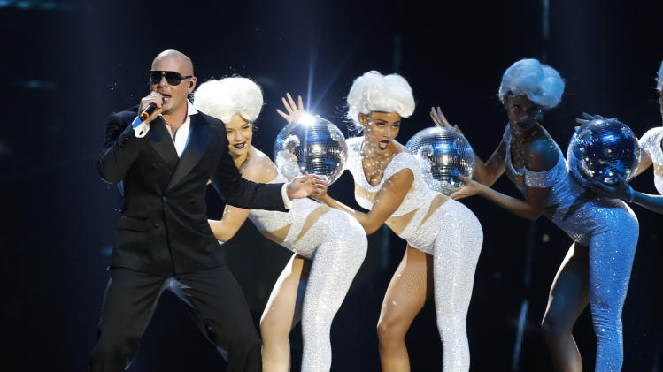 US rapper Pitbull performs during the 2012 MTV European Music Awards show at the Festhalle in Frankfurt, central Germany, Sunday, Nov. 11, 2012. (AP Photo/Michael Probst)