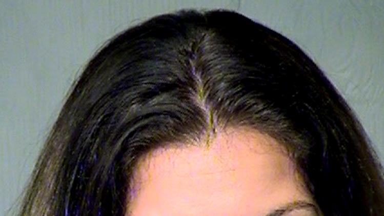 In this Maricopa County Sheriff's Office booking mug shot from May 2, 2012, in Phoenix, Jami Lynn Toler, 27, was charged with fraud and theft after authorities said she told people she had breast cancer and needed treatment, only to use the charitable funds she got to get breast implants. (AP Photo/Maricopa County Sheriff's Office)