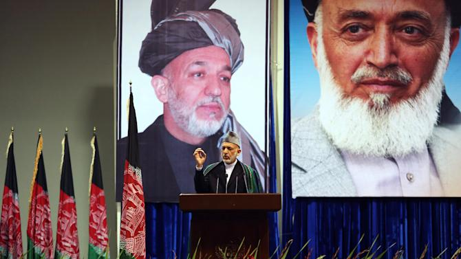 Afghan President Hamid Karzai speaks during a ceremony marking the third anniversary of the assassination of former Afghan President Burhanuddin Rabbani in Kabul, Afghanistan, Saturday, Sept. 20, 2014. In 2011, an insurgent with a bomb wrapped in his turban assassinated Rabbani, who was leading a government effort to broker peace with the Taliban. (AP Photo/Rahmat Gul)