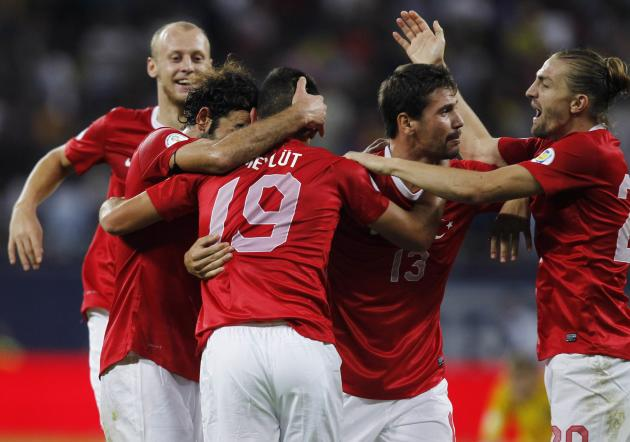 Turkey's Erding celebrates with his teammates after scoring a goal against Romania during their 2014 World Cup qualifying soccer match in Bucharest