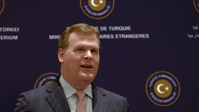 Canadian Foreign Minister John Baird talks to the media with Turkish counterpart Ahmet Davutoglu, not pictured, during a joint news conference after talks on security and terror threats in the mideast region, in Istanbul, Turkey, Saturday, Sept. 14, 2013. Baird is in Turkey for talks on security issues including the ongoing situation in Syria. (AP Photo)