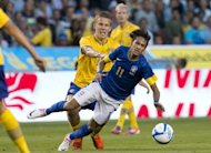Brazil's Neymar (R) vies with Pontus Wernbloom during a friendly football match between Brazil and Sweden. Brazil won a 3-0 victory over Sweden