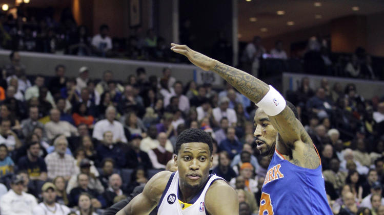 Memphis Grizzlies' Rudy Gay (22) drives past New York Knicks' J.R. Smith (8) during the second half of an NBA basketball game in Memphis, Tenn., Friday, Nov. 16, 2012. The Memphis Grizzlies defeated the New York Knicks 105-95. (AP Photo/Danny Johnston)