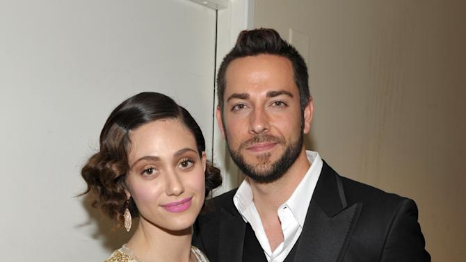 Actors Emmy Rossum, left, and Zachary Levi pose backstage at the 21st Annual 'A Night at Sardi's' to benefit the Alzheimer's Association at the Beverly Hilton Hotel on Wednesday, March 20, 2013 in Beverly Hills, Calif. (Photo by John Shearer/Invision for Alzheimer's Association/AP Images)