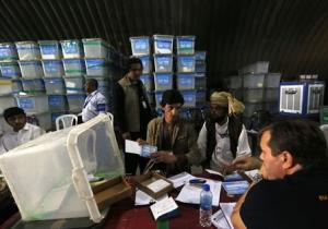 Afghan election workers count ballot papers for audit of presidential run-off in Kabul
