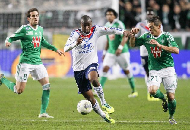 Fofana of Olympique Lyon challenges Hamouma of St Etienne during French Ligue 1 match in Saint-Etienne