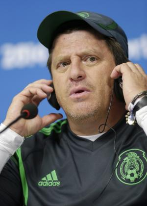 Head coach of Mexico Miguel Herrera adjusts his headphones during a press conference at the Arena Pernambuco in Recife, Brazil, Sunday, June 22, 2014. Mexico will play Croatia in a group A match of the 2014 soccer World Cup. (AP Photo/Petr David Josek)