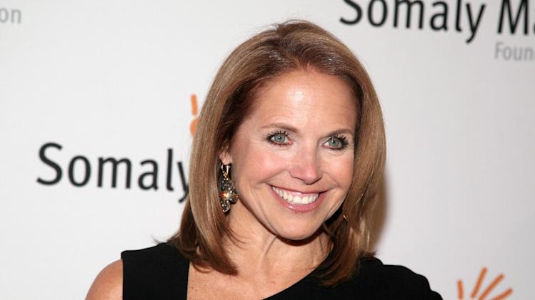 "FILE - This Oct. 23, 2013 file photo shows TV host Katie Couric at the Somaly Mam Foundation Gala in New York. Couric is calling it quits on her weekday talk show as she heads to Yahoo. Couric and Disney-ABC, which produces the syndicated ""Katie"" show, said Thursday, Dec. 19, 2013 it will wrap after this, its second season. (Photo by Andy Kropa/Invision/AP, File)"