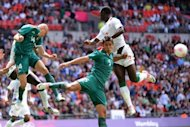 Senegal&#39;s forward Moussa Konate (R) challenges Mexico&#39;s midfielder Jorge Enriquez (L) and defender Darvin Chavez (C) for the ball in their Olympic quarter-final at Wembley Stadium in London. Mexico won 4-2