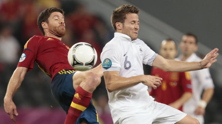 France's Yohan Cabaye, right, and Spain's Xabi Alonso go for the ball during the Euro 2012 soccer championship quarterfinal match between Spain and France in Donetsk, Ukraine, Saturday, June 23, 2012. (AP Photo/Ivan Sekretarev)