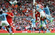 Liverpool's Slovakian defender Martin Skrtel (2nd R) scores from a header during the English Premier League football match between Liverpool and Manchester City at Anfield stadium in Liverpool. The match ended in a 2-2 draw
