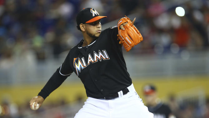 Alvarez pitches Marlins past Mariners 7-0