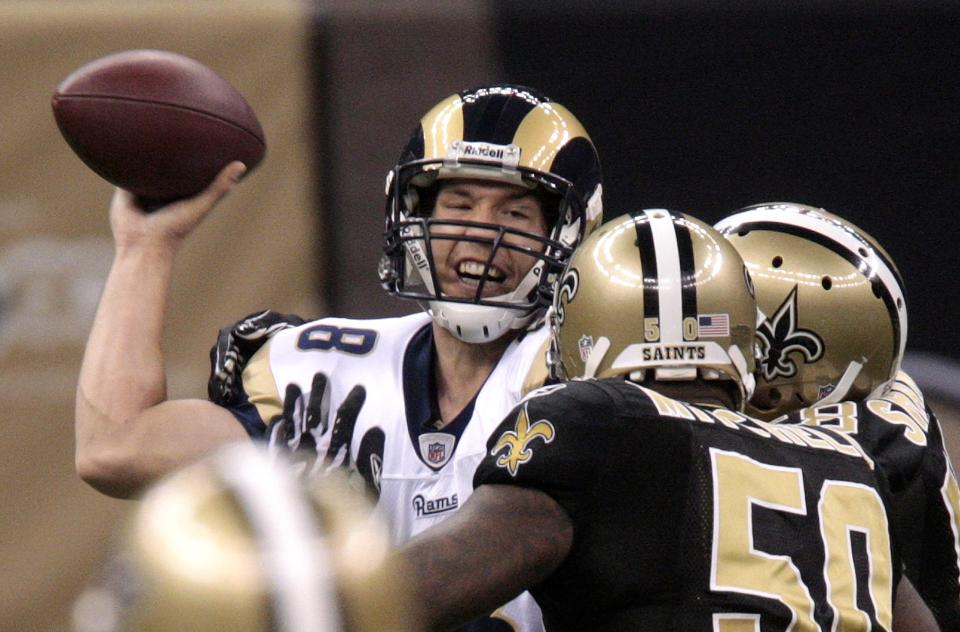 St. Louis Rams quarterback Sam Bradford (8) is hurried by New Orleans Saints linebacker Marvin Mitchell (50) in the first half of an NFL football game at the Louisiana Superdome in New Orleans, Sunday, Dec. 12, 2010. The Saints defeated the Rams 31-13. (AP Photo/Bill Haber)