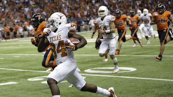 Texas' Marquise Goodwin (84) runs for a 64-yard touchdown during the second quarter of the Alamo Bowl NCAA football game against Oregon State, Saturday, Dec. 29, 2012, in San Antonio.  (AP Photo/Eric Gay)