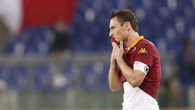 AS Roma's Francesco Totti reacts during their Italian Serie A soccer match against Cagliari at the Olympic stadium in Rome February 1, 2013 (Reuters)