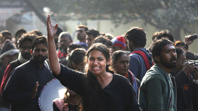 An Indian girl shouts during a protest in New Delhi, India, Monday, Dec. 31, 2012. The gang-rape and killing of a New Delhi student has set off an impassioned debate about what India needs to do to prevent such a tragedy from happening again. The country remained in mourning Monday, two days after the 23-year-old physiotherapy student died from her internal wounds in a Singapore hospital. AP Photo/Manish Swarup)