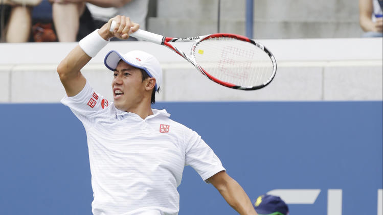 Kei Nishikori, of Japan, returns a shot to Leonardo Mayer, of Argentina, during the third round of the 2014 U.S. Open tennis tournament, Saturday, Aug. 30, 2014, in New York. (AP Photo/Seth Wenig)