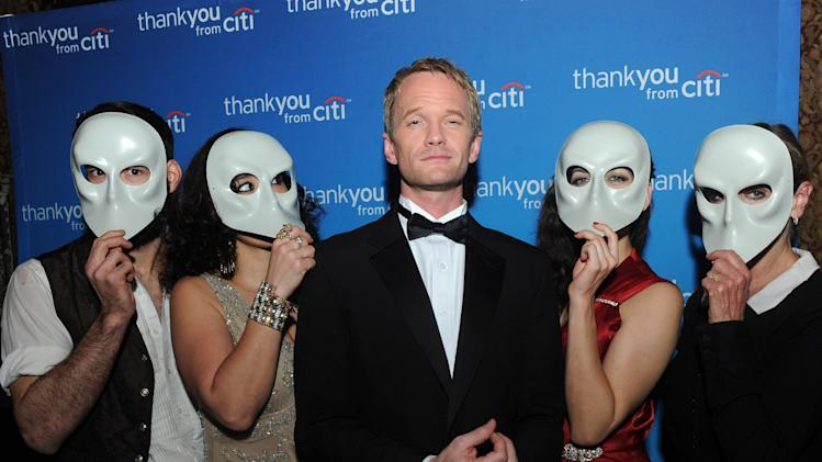 "IMAGE DISTRIBUTED FOR CITI - Neil Patrick Harris poses with ""Sleep No More"" cast members during an exclusive event for Citi ThankYou customers at The McKittrick Hotel, home of ""Sleep No More,"" Monday, Dec. 9, 2013, in New York. (Photo by Diane Bondareff/Invision for Citi/AP Images)"