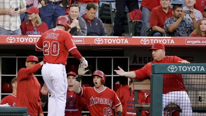 Los Angeles Angels' Matt Joyce is greeted in the dugout after a home run against the Detroit Tigers during the second inning of a baseball game in Anaheim, Calif., Thursday, May 28, 2015. (AP Photo/Chris Carlson)