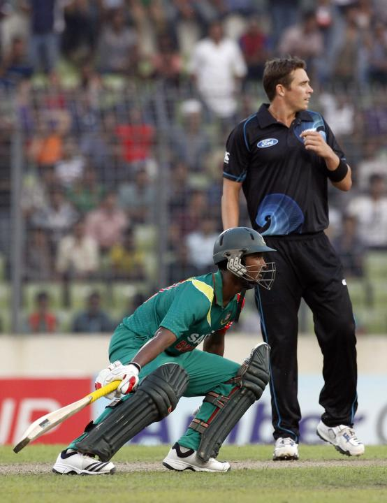 Bangladesh's Naeem Islam runs between the wickets as New Zealand's Tim Southee watches the ball during their first ODI cricket match in Dhaka