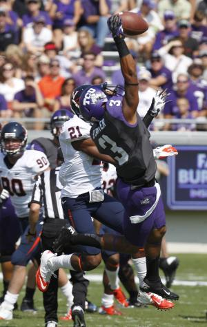 TCU wide receiver Brandon Carter (3) pulls in a touchdown pass in front of Virginia safety Brandon Phelps (21) during the first half on an NCAA college football game Saturday, Sept. 22, 2012, in Fort Worth, Texas. (AP Photo/LM Otero)