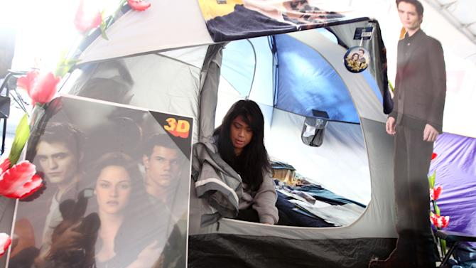"""Joanne Lassiter, of Los Angeles, is seen in her tent at the Twilight fan camp ahead of the world premiere of """"The Twilight Saga: Breaking Dawn - Part 2"""" on Friday, Nov. 9, 2012 in Los Angeles. The premiere will be held Nov. 12. (Photo by Matt Sayles/Invision/AP)"""