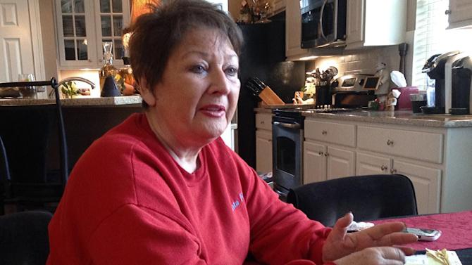 """Anita Barney talks about losing her fortune in a swindle perpetrated by former Ohio State quarterback Art Schlichter, followed by her own role stealing nearly $500,000 from friends on Schlichter's instructions, on Dec. 15, 2015, in Dublin, Ohio. Barney, the widow of an ex-Wendy's CEO, has written a book, """"Quarterback Sneak,"""" about her experiences, which included pleading guilty in 2012 to two felony theft charges. (AP Photo/Andrew Welsh-Huggins)"""