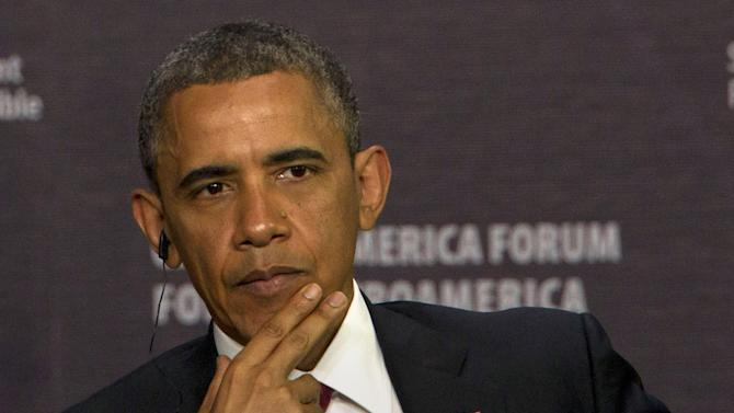 President Barack Obama listens a question as he participates in an economic forum in San Jose, Costa Rica, Saturday, May 4, 2013. (AP Photo/Moises Castillo)