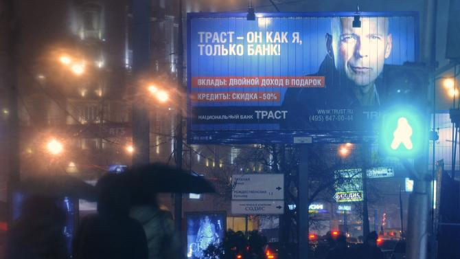 File picture shows a billboard advertisement for Trust Bank, featuring an image of Hollywood actor Bruce Willis, in Moscow