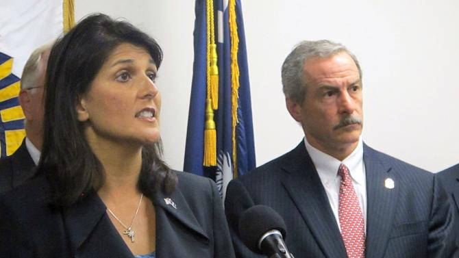 South Carolina Gov. Nikki Haley and Chief Mark Keel of the South Carolina Law Enforcement Division answer questions at a news conference in Columbia S.C. on Friday, Oct. 26th. Officials announced that 3.6 million state tax returns going back to 1998 had been exposed in an international cyber attack. (AP Photo/Bruce Smith)
