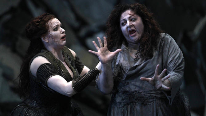 """In this photo taken Tuesday, Oct. 2, 2012, in Chicago, from left, Emily Magee as Chrysothemis, and Christine Goerke as Elektra, perform during the first act of a dress rehearsal of the Lyric Opera of Chicago's new production of """"Elektra."""" (AP Photo/M. Spencer Green)"""