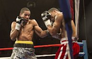 Lamont Peterson (L) works Kendall Holt against the ropes in the eighth round, on February 22, 2013. Peterson, once a homeless child on the streets of the US capital, where he defended his title, improved to 31-1-1 with his 16th stoppage inside the distance