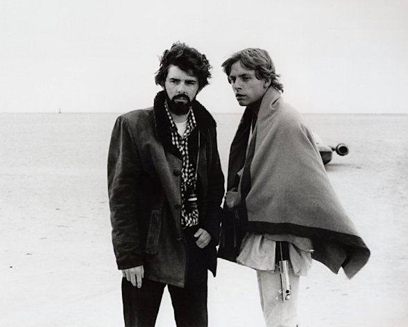 "In this March 1976 publicity photo released by Lucasfilm Ltd. & TM, director, George Lucas, and actor, Mark Hamill, who portrays young Luke Skywalker, are shown on the salt flats of Tunisia during principal photography of the original ""Star Wars."" There's no mistaking the similarities. A childhood on a dusty farm, a love of fast vehicles, a rebel who battles an overpowering empire, George Lucas is the hero he created, Luke Skywalker. (AP Photo/Lucasfilm Ltd. & TM)"