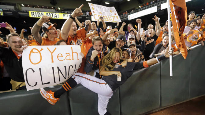 10ThingstoSeeSports - Baltimore Orioles center fielder Adam Jones celebrates with fans after a baseball game against the Toronto Blue Jays, Tuesday, Sept. 16, 2014, in Baltimore. Baltimore won 8-2 to clinch the American League East. (AP Photo/Patrick Semansky, File)