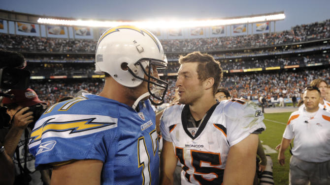 Denver Broncos quarterback Tim Tebow (15), right, talks with San Diego Chargers quarterback Philip Rivers (17) after an NFL football game Sunday, Nov. 27, 2011 in San Diego.  The Broncos won 16-13. (AP Photo/Denis Poroy)