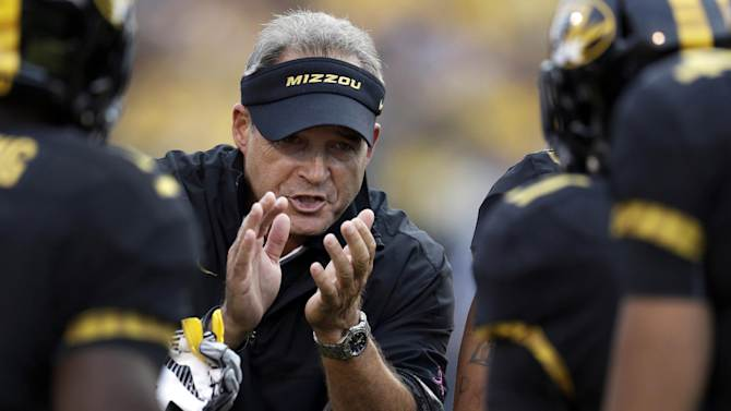 FILE- In this Sept.15, 2012, file photo, Missouri head coach Gary Pinkel applauds his team after a score during the first quarter of an NCAA college football game against Arizona State in Columbia, Mo. Nick Saban will have a reunion of sorts from Kent State's 1972 Mid-American Conference championship team, since he couldn't make the first one. The Alabama coach was a safety on that team 40 years ago, while Missouri's Pinkel was the star tight end. They'll be opposing coaches for the first time Saturday in Columbia, Mo., instead of teammates and co-workers. (AP Photo/Jeff Roberson, File)