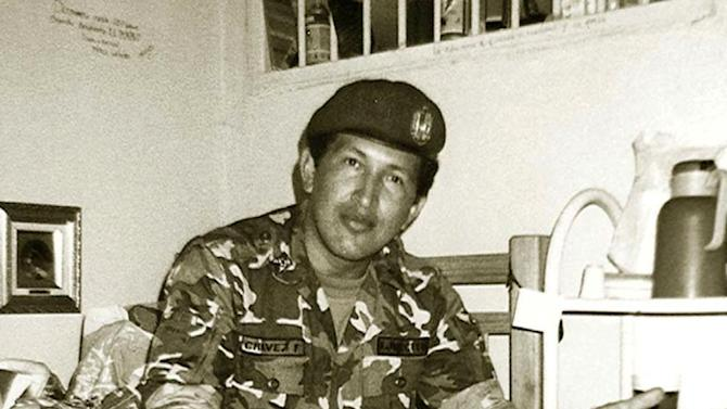 In this undated photo released by Miraflores Press Office, Hugo Chavez poses as he serves time in the Yare II prison near Caracas, Venezuela. During more than eight years covering Venezuela, James says he has gained more street smarts, become a tougher, more resourceful reporter and developed a deep affection for Venezuela. During an interview with James, Chavez talked about his years as an army officer plotting against the government and how growing up in the rural plains had shaped his radical ideas. (AP Photo/Miraflores Press Office)