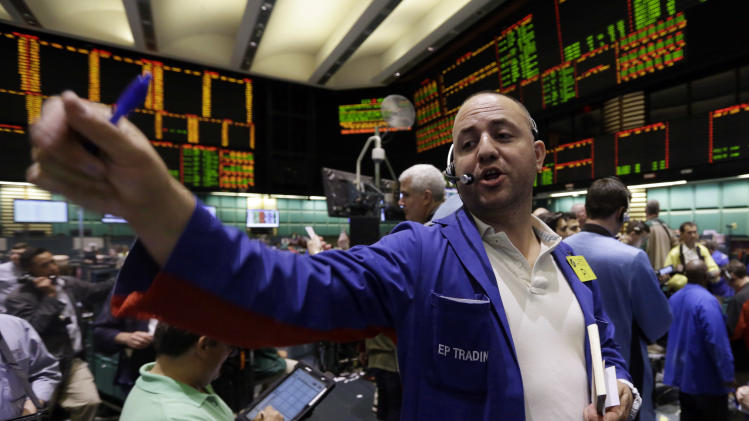 Trader Peter Iocolano works in the oil options pit at the New York Mercantile Exchange Wednesday, July 3, 2013. Oil climbed above $101 a barrel as the political crisis in Egypt intensified. (AP Photo/Richard Drew)