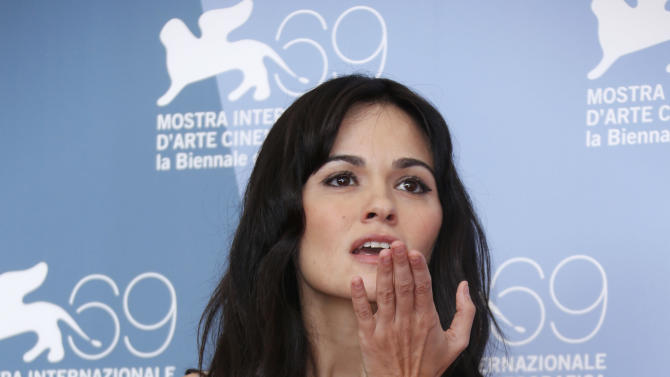 Actress Romina Mondello poses at the photo call of the film 'To The Wonder' at the 69th edition of the Venice Film Festival in Venice, Italy, Sunday, Sept. 2, 2012. (AP Photo/Joel Ryan)